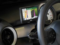 Integrated navigation device for MINI vehicles